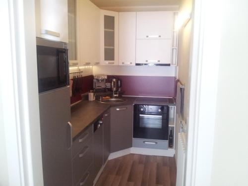 A kitchen or kitchenette at Central Apartment Trnava