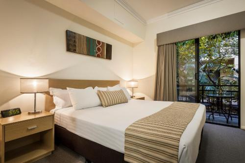 A bed or beds in a room at Best Western Northbridge Apartments