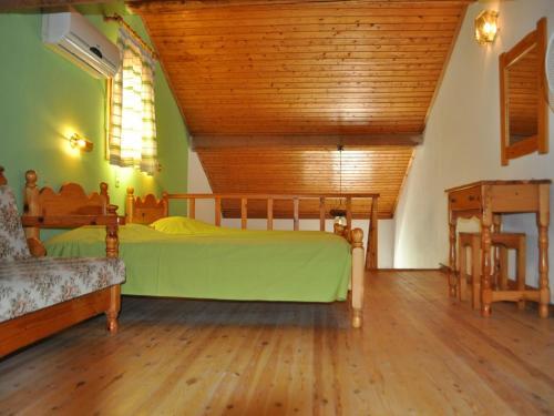 Ένα ή περισσότερα κρεβάτια σε δωμάτιο στο Makis & Bill Apartments