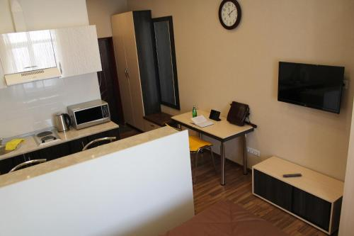A television and/or entertainment centre at Rent Apartments Premium Class