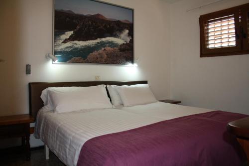 Cama o camas de una habitación en Apartamentos Mayagüez - Adults Only