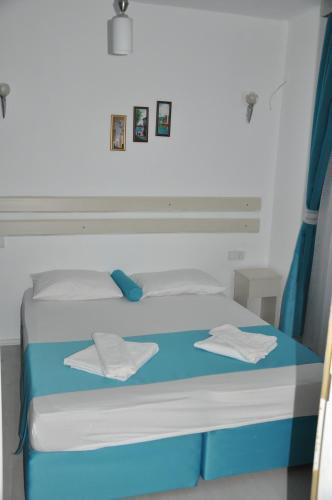 Кровать или кровати в номере Hotel Nisa