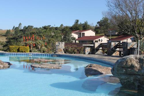 The swimming pool at or near Panorama Chalets & Rest Camp