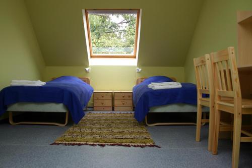 Voodi või voodid majutusasutuse Laugu Guesthouse toas