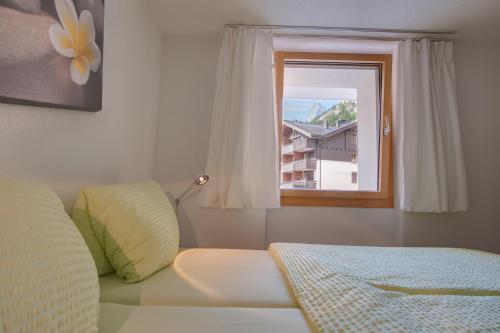 Cama o camas de una habitación en Cabana Apartments