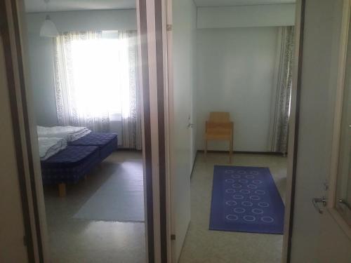 Кровать или кровати в номере Leinon Apartments