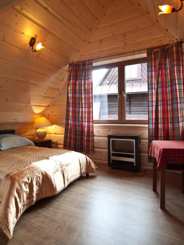 Cama o camas de una habitación en Pensjonat Maria