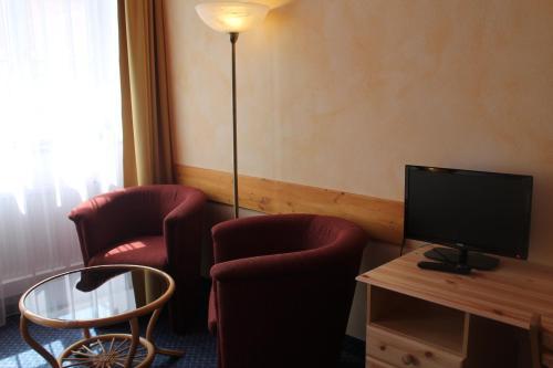 A seating area at City Apartment Hotel Hamburg