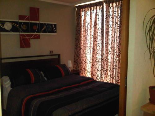 Cama o camas de una habitación en Providencia Apart