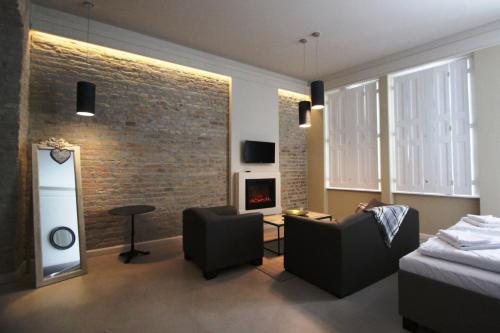 אזור ישיבה ב-Heritage Home Apartments