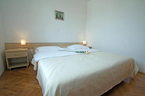 Ein Bett oder Betten in einem Zimmer der Unterkunft Apartments Tamarix