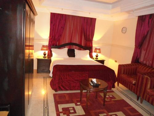 A bed or beds in a room at Al Rahaba Almomaiazah Furnished Units 6