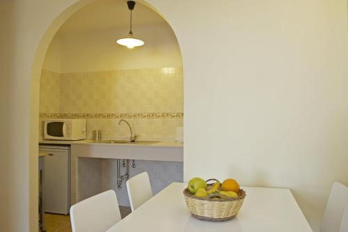 A kitchen or kitchenette at Apartamentos San Francisco