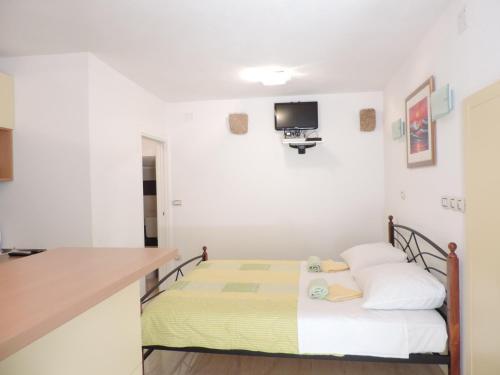 מיטה או מיטות בחדר ב-Studio Josip