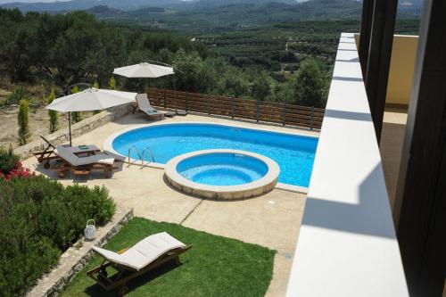 A view of the pool at Villa Nimertis or nearby