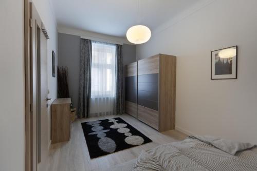 Ein Bett oder Betten in einem Zimmer der Unterkunft Old Town City Center Navratilova