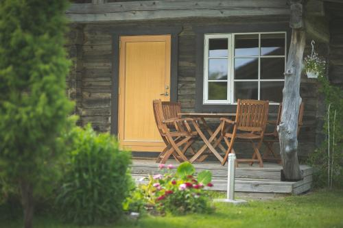 A porch or other outdoor area at Arina Cottages