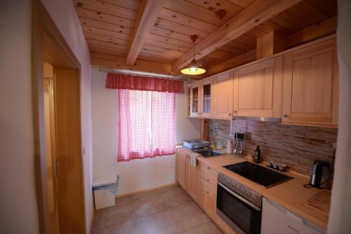 A kitchen or kitchenette at Apartments Mojca