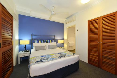 A bed or beds in a room at Reef Club Resort