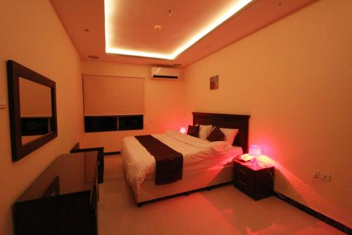 A bed or beds in a room at Wardnal Furnished Units