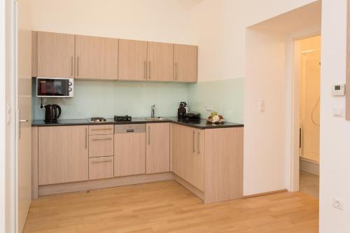 Küche/Küchenzeile in der Unterkunft Yourapartment 1030
