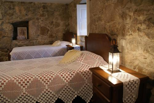 A bed or beds in a room at Casa Real Danaia
