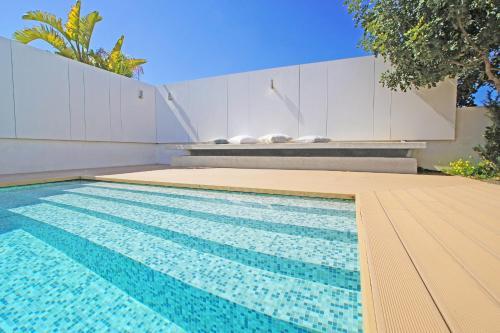 The swimming pool at or near Villa Melina