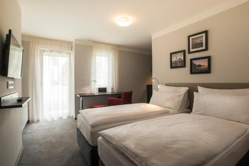 A bed or beds in a room at The Stay.residence