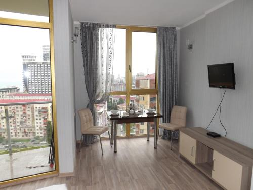 A television and/or entertainment center at Orbi Plaza Apartment