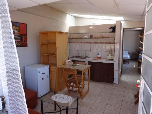 Una cocina o zona de cocina en Departamentos Mariscal Cusco