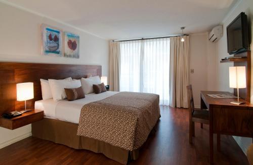 Cama o camas de una habitación en Park Plaza Apart Hotel