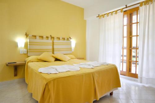Una cama o camas en una habitación de Condominio Octogono