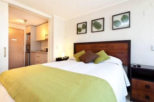 Cama ou camas em um quarto em Departamentos Costa Nueva de Lyon