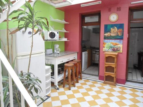 A kitchen or kitchenette at Tango Cozy Home