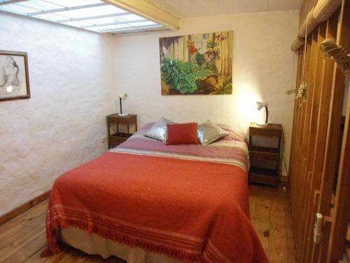 A bed or beds in a room at Tango Cozy Home