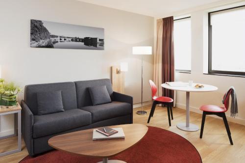 Гостиная зона в Aparthotel Adagio Toulouse Centre Ramblas