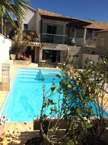 A piscina localizada em Pousada Recanto do Alecrim ou nos arredores
