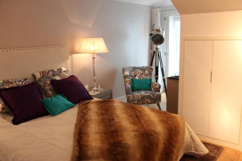 A bed or beds in a room at Miradouro de Lisboa