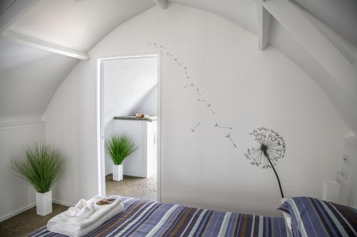 A bed or beds in a room at The Dome House - Waiheke Island
