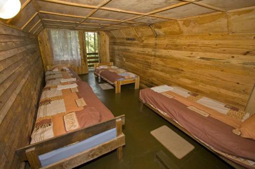 A bed or beds in a room at Madaras
