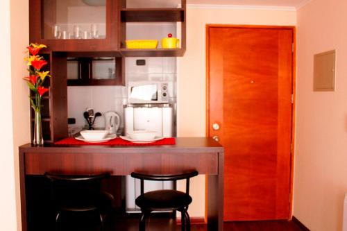 Una cocina o zona de cocina en Departamentos amoblados Sol de Monjitas