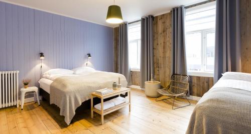 Rúm í herbergi á Old Charm Reykjavik Apartments