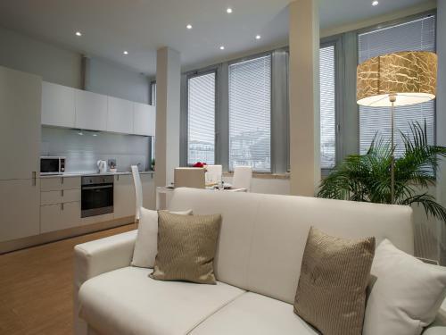 Een zitgedeelte bij La Farina Apartments