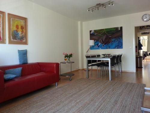 Coin salon dans l'établissement Appartement aan Zee Oostende