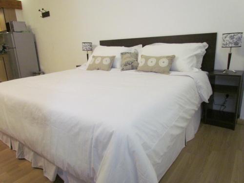 Una cama o camas en una habitación de Apartment Costas Del Nahuel