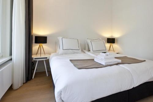 Ein Bett oder Betten in einem Zimmer der Unterkunft Cityden Old Centre Serviced Apartments