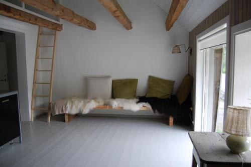 A bed or beds in a room at Patina Evanger