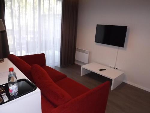 Télévision ou salle de divertissement dans l'établissement Résidence Les Rives de la Fecht - Colmar Ouest