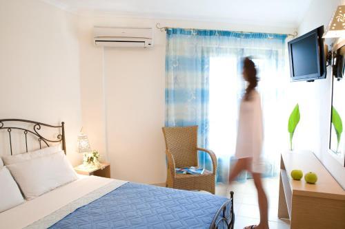 Ένα ή περισσότερα κρεβάτια σε δωμάτιο στο Anemolia Apartments