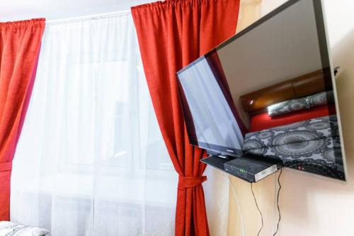 A television and/or entertainment center at BatmanHome Apartment